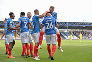 Portsmouth Players Celebrate after Portsmouth Midfielder, Gareth Evans (26) scores a goal to make it 1-0 during the EFL Sky Bet League 1 match between Portsmouth and Oxford United at Fratton Park, Portsmouth, England on 18 August 2018.