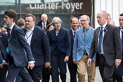 © Licensed to London News Pictures . 02/10/2017. Manchester, UK. THERSA MAY and PHILIP MAY leave the conference hall surrounded by delegates , after Philip Hammond's speech , during the second day of the Conservative Party Conference at the Manchester Central Convention Centre . Photo credit: Joel Goodman/LNP