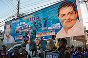 TEGUCIGALPA, HONDURAS - NOVEMBER 12, 2013: People stand next to election banners promoting National Party candidates during a rally in Tegucigalpa, Honduras. Honduras will hold general elections on November 24. CREDIT: Rodrigo Cruz for The New York Times