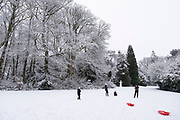 Local people enjoy playing in the snow in Highbury Park in Kings Heath on 24th January 2021 in Birmingham, United Kingdom. Deep snow arrived in the Midlands giving some light relief and fun during the current lockdown for people who simply enjoyed the weather.