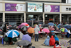 © Licensed to London News Pictures. 03/06/2012. Bristol, UK. Crowds watch the Thames pageant on a big screen in Millenium Square, Bristol Harbourside. The Royal Jubilee celebrations. Great Britain is celebrating the 60th  anniversary of the countries Monarch HRH Queen Elizabeth II accession to the throne this weekend Photo credit : Simon Chapman/LNP