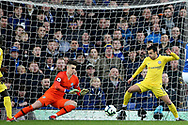 Chelsea goalkeeper Kepa Arrizabalaga (1) and Chelsea midfielder Pedro (11) keep out another Everton attack during the Premier League match between Everton and Chelsea at Goodison Park, Liverpool, England on 17 March 2019.