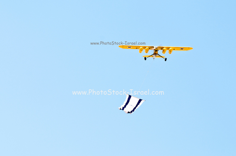 Israel, Massada Air Strip, the international radio controlled model aircraft competition June 27 2009. A model tows an Israeli Flag