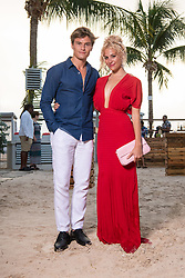 EDITORIAL USE ONLY Pixie Lott and Oliver Cheshire at the launch of Virgin Holidays Departure Beach in Barbados.