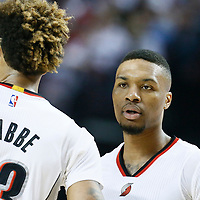 25 April 2016: Portland Trail Blazers guard Damian Lillard (0) talks to Portland Trail Blazers guard Allen Crabbe (23) during the Portland Trail Blazers 98-84 victory over the Los Angeles Clippers, during Game Four of the Western Conference Quarterfinals of the NBA Playoffs at the Moda Center, Portland, Oregon, USA.
