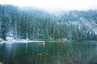 Canoeing on alpine lake near Mt Rainier National Park.