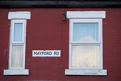 © Licensed to London News Pictures . 22/11/2013 . Manchester , UK . Street sign on the front of number 18 Mayford Road . Police and forensic scenes of crime investigators on the scene at 18 Mayford Road , Levenshulme , where the body of a 49 year old mother of four , Aisha Alam , was discovered stabbed to death today (Friday 22nd November 2013) after a man , understood to be Aisha's husband , walked in to Longsight Police Station to report she had been killed . Photo credit : Joel Goodman/LNP