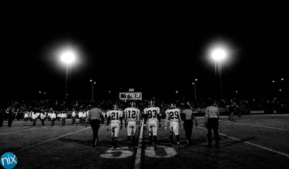 A.L. Brown captains Kaleel Hollis (21), Damien Washington (12), Gerald Holt (93) and Steven Jordan (29) takes the field prior to a game against Charlotte Catholic during the third round of the NCHSAA 3AA playoffs Friday night in Charlotte. Charlotte Catholic won the game 35-9 to end the Wonder's season. (Photo by James Nix)
