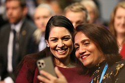 © Licensed to London News Pictures. 04/10/2021. Manchester, UK.  Home Secretary Priti Patel poses for a selfie before a speech by Chancellor Rishi Sunak at the Conservative Party Conference on Monday. The annual Conservative Party Conference has returned to Manchester this year after being held online in 2020. Photo credit: Adam Vaughan/LNP