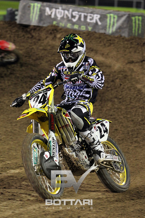 LAS VEGAS, NV - OCTOBER 15:  Brett Metcalfe, rider of the #24 Rockstar Makita Suzuki 450, races during Main Event 1 of the inaugural Monster Energy Cup on October 15, 2011 in Las Vegas, Nevada.  (Photo by Jeff Bottari/Getty Images)