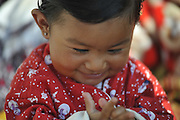 Dec. 29, 2015 - Kathmandu, NP, Nepal -<br /> <br /> Earthquake Survivors struggling in temporary Tent on Winter Season<br /> <br /> PRISHA MAHARJAN, 10 months old, smiles after applying mustard oil by her grandmother, which can offer numerous health benefits for infants and kids. Some of which are that it is very good for baby massage, it can keep the body warm during winters, on 29 December, 2015 at Panga, Kirtipur, Kathmandu, Nepal. Most of houses in Panga, Kirtipur were destroyed by recent earthquake on April 25, 2015, a magnitude of 7.8 earthquake killing over 8,000 of people in Nepal and thousands of injured, which Outcomes Hundreds of people were homeless with entire villages across many districts of the country. <br /> ©Exclusivepix Media