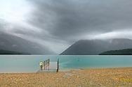 Lake Rototiti under heavy overcast skies and rain. Nelson Lakes, New Zealand