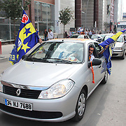 Fenerbahce's supporters on the road with their cars shows the Fenerbahce flag before their Turkish Super Cup 2012 soccer derby match Galatasaray between Fenerbahce at the Kazim Karabekir stadium in Erzurum Turkey on Sunday, 12 August 2012. Photo by TURKPIX