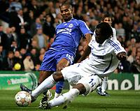Photo: Tom Dulat.<br /> Chelsea v Shalke 04. Group B, UEFA Champions League. 24/10/2007.<br /> Gerald Asamoah of Shalke 04 and Florent Malouda of Chelsea with the ball.