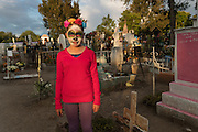 A young girl dressed as La Calavera Catrina visits the Nuestra Señora de Guadalupe cemetery during the Day of the Dead festival November 1, 2016 in San Miguel de Allende, Guanajuato, Mexico. The week-long celebration is a time when Mexicans welcome the dead back to earth for a visit and celebrate life.
