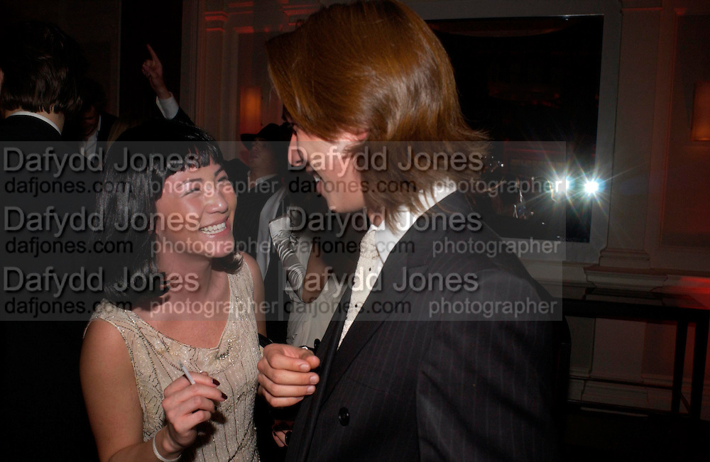 Rebecca Tang  and Edward Tang. Andy & Patti Wong's Chinese New Year party to celebrate the year of the Rooster held at the Great Eastern Hotel, Liverpool Street, London.29th January 2005. The theme was a night of hedonism in 1920's Shanghai. . ONE TIME USE ONLY - DO NOT ARCHIVE  © Copyright Photograph by Dafydd Jones 66 Stockwell Park Rd. London SW9 0DA Tel 020 7733 0108 www.dafjones.com