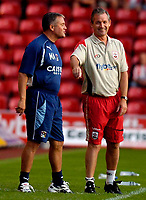 Photo: Alan Crowhurst.<br />Southampton v Coventry City. Coca Cola Championship. 09/08/2006. Mickey Adams (L) the Coventry coach shares a joke with George Burley the Saints coach.