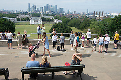 © Licensed to London News Pictures 23/07/2021. Greenwich, UK. People making the most of a heatwave afternoon in Greenwich park, London before a weekend of torrential rain and thunderstorms spoil the nice weather party. Photo credit:Grant Falvey/LNP