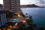 The Halekulani Hotel, the Hawaiian name meaning House Befitting Heaven, located on Waikiki beach in Honolulu, Hawaii offers stunning views of Diamond Head in a historic, secluded and exclusive setting. The view from the Diamond Head Suite, room 1466