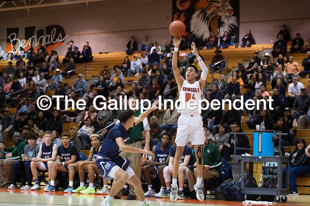 Gallup's Quinn Atazhoon (24) makes a jump shot against Rio Rancho at Gallup High School Tuesday night in Gallup.