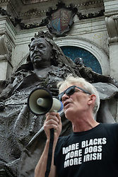 © Licensed to London News Pictures. 30/08/2020. Manchester, UK. A speech is made on the steps at the foot of the Victoria Statue in Piccadilly Gardens . Protesters and campaigners hold a combined Extinction Rebellion and Black Lives Matter protest in Manchester City Centre , during which statues and memorials are rededicated with new historical context highlighting the slave trade . Photo credit: Joel Goodman/LNP