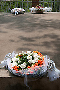 Rwanda February 2014. Kigali Genocide Memorial. .A wreath of flowers lies on one of the mass graves. 250,000 people are buried here, victims of 1994 genocide when an estimated 800,000 to one million people were savagely killed in 100 days ,starting on April 7th when the President's plane was shot down.