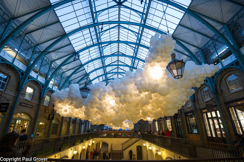 Covent Garden has commissioned artist Charles Pétillon to create a striking, large-scale installation, composed of 100,000 white balloons.The installation stretching 54 metres in length and 12 metres in width, incorporating gentle continuous pulsating white light to symbolise the beating of a heart. The work is titled 'Heartbeat'. will hang in the ceiling space of the South Hall Market Building.Pic Shows the Installation which opens to the public on August 27th 2015