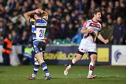 Micky Young (Bath) walks away dejected at the final whistle as Tom Brady (Sale Sharks) celebrates - Photo mandatory by-line: Patrick Khachfe/JMP - Tel: Mobile: 07966 386802 28/03/2014 - SPORT - RUGBY UNION - The Recreation Ground, Bath - Bath Rugby v Sale Sharks - Aviva Premiership.