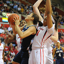 Notre Dame Fighting Irish forward Natalie Achonwa (11) grabs a rebound away from Rutgers Scarlet Knights guard/forward Betnijah Laney (44) during first half NCAA Big East women's basketball action between Notre Dame and Rutgers at the Louis Brown Athletic Center. Notre Dame leads 40-23 at halftime.