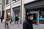 Asthe national lockdown ends and the new three tier system of local coronavirus restrictions begins, shoppers head out to Oxford Street to catch up on shopping as non-essential shops like fashion retailer Primark are allowed to reopen on 2nd December 2020 in London, United Kingdom. Many shoppers wear face masks outside on the street as a precaution as there are so many people around.