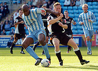 Photo: Henry Browne.<br /> Coventry City v Hull City. Coca Cola Championship.<br /> 24/09/2005.<br /> Dele Adebola of Coventry fends off Roland Edge of Hull.