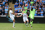 Andre Ayew of Swansea city (l) is challenged by Bacary Sagna of Manchester city. Barclays Premier league match, Swansea city v Manchester city at the Liberty Stadium in Swansea, South Wales on Sunday 15th May 2016.<br /> pic by Andrew Orchard, Andrew Orchard sports photography.