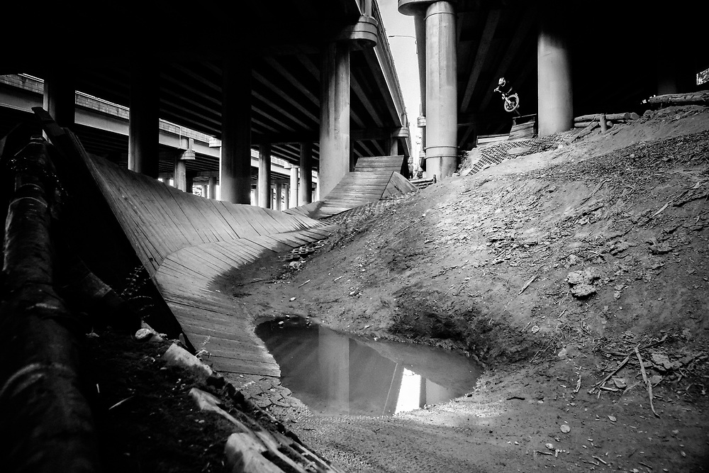 Jonathan Jacobson grabs air at the I-5 Colonnade park in Seattle, Washington.