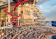 Royal Caribbean, Harmony of the Seas, the AquaTheater is an amphitheater-style entertainment space celebrating water with a full spectrum of activities including water and light shows, professional aquatic acrobatic and synchronized swimming performances