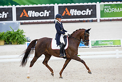 Karin Kosak, (AUT), Lucy's Day - Grand Prix Team Competition Dressage - Alltech FEI World Equestrian Games™ 2014 - Normandy, France.<br /> © Hippo Foto Team - Leanjo de Koster<br /> 25/06/14