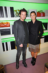 CHRISTOPHER KANE and TAMMY KANE at a party hosted by Prada to celebrate launch of a book documenting the company's diverse projects in fashion, architecture, film and art held at their store 16/18 Old Bond Street, London on 19th November 2009.