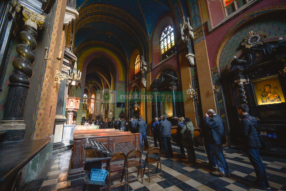 April 14, 2017 - Krakow, Poland - People queuing for confession inside the Franciscan Basilica in Krakow..On Friday, April 14, 2017, in Krakow, Poland. (Credit Image: © Artur Widak/NurPhoto via ZUMA Press)
