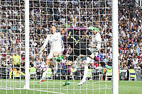 Sergio Ramos and Cristiano Ronaldo of Real Madrid  competes for the ball with Marc-Andre Ter Stegen of FC Barcelona during the match of La Liga between Real Madrid and Futbol Club Barcelona at Santiago Bernabeu Stadium  in Madrid, Spain. April 23, 2017. (ALTERPHOTOS)