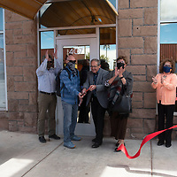 A ribbon cutting ceremony is performed by Children, Youth & Families Department Cabinet Secretary Brian Blalock and Gallup Mayor Louie Bonaguidi at the Lexington Hotel Tuesday in Gallup.