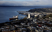 In this aerial from the top of the Space Needle, lower Queen Anne is in the foreground, the former Fisher Flour grain terminal with a ship docked, center, and Magnolia beyond, including the Magnolia Bridge. The Elliott Bay Marina is top,center. (Alan Berner / The Seattle Times)