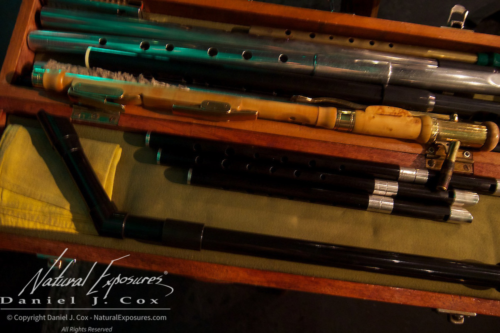 Tom's case of wind instruments known as Irish Flutes which can be plastic, wooden or tin. Merry Ploughboy Pub, Dublin, Ireland.