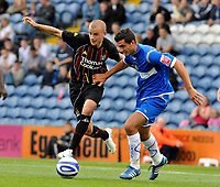Manchester City's Vladimir Weiss (L) battles for the ball with Stockport County's Jimmy McNulty<br />