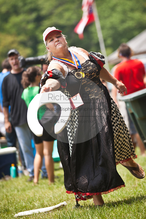 A contestant in the toilet seat horseshoe competition during the annual Summer Redneck Games Dublin, GA.