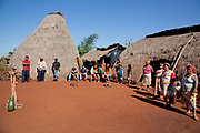 Guarani community watching a traditional dance. The Guarani are one of the most populous indigenous populations in Brazil, but with the least amount of land. They mostly live in the State of Mato Grosso do Sul and Mato Grosso. Their tradtional way of life and ancestral land is increasingly at risk from large scale agribusiness and agriculture. There have been recorded cases and allegations of violence between owners of large farms and the Guarani communities in this region.