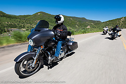 Robert Doyle of Rapid City, SD and member of the Black Hills HOG Chapter on his Street Glideriding the 20 Mile Road in Steamboat Springs during the Rocky Mountain Regional HOG Rally, Colorado, USA. Saturday June 10, 2017. Photography ©2017 Michael Lichter.