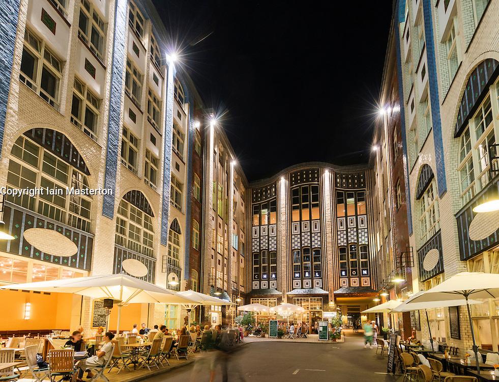 Busy restaurants in courtyard or Hof at Hackesche Hofe at Hackescher Markt in Mitte Berlin Germany