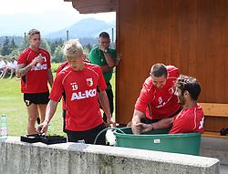 14.07.2013, Walchsee, AUT, FC Augsburg, Trainingslager, im Bild Halil ALTINTOP (FC Augsburg #7) sitzt in der Tonne mit Eiswasser nach dem Training, mit Sascha MvÒLDERS, MOELDERS (FC Augsburg #33) und Matthias OSTRZOLEK (FC Augsburg #19) // during a trainings session of German 1st Bundesliga club FC Augsburg at their training camp in Walchsee, Austria on 2013/07/14. EXPA Pictures © 2013, PhotoCredit: EXPA/ Eibner/ Klaus Rainer Krieger<br /> <br /> ***** ATTENTION - OUT OF GER *****