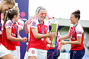 Arsenal forward Katie McCabe (15)  with the WSL trophy after  the FA Women's Super League match between Arsenal Women FC and Manchester City Women at Meadow Park, Borehamwood, United Kingdom on 12 May 2019.