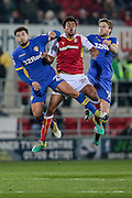 Tom Adeyemi (on loan from Cardiff City) (Rotherham United), Kalvin Phillips (Leeds United) and Eunan O'Kane (Leeds United) jump for the ball during the EFL Sky Bet Championship match between Rotherham United and Leeds United at the New York Stadium, Rotherham, England on 26 November 2016. Photo by Mark P Doherty.