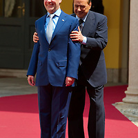MILAN, ITALY - JULY 23:    Italian Prime Minister Silvio Berlusconi swap place with Russian President Dimitry Medvedev during the welcoming at Palazzo della Provincia on July 23, 2010 in Milan, Italy. Italian Prime Minister Berlusconi and Russian President Medvedev will discuss issues related to Russia's relations with NATO and the EU, energy security, and the development of bilateral trade and economic relations. .***Agreed Fee's Apply To All Image Use***.Marco Secchi /Xianpix. tel +44 (0) 207 1939846. e-mail ms@msecchi.com .<br />  www.marcosecchi.com